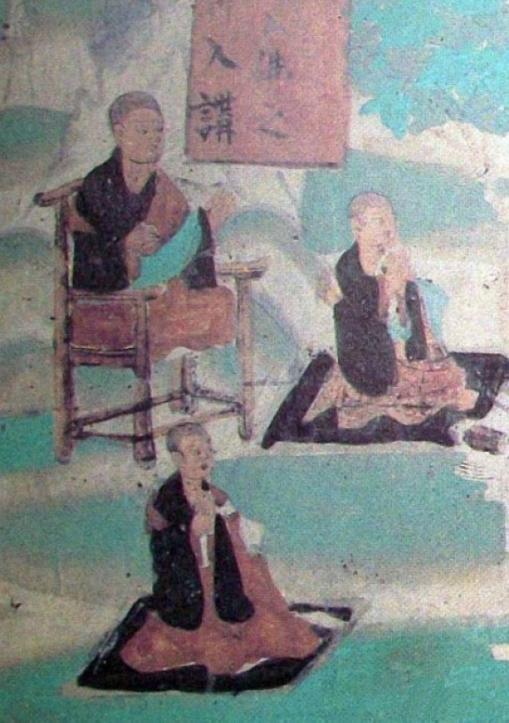 """敦煌壁画第61窟东壁北侧维摩诘经变中(五代时期) 四出头官帽椅一般由黄花梨制作而成。它与紫檀被称为最""""雅静""""的木材。黄花梨色泽秀润,纹理变化无穷,在华贵之中又带有素雅的美。因此,深为为文人雅石所钟爱,所以官帽椅又有别称为""""文椅""""。即使是在今天,文人学者参加一些比较隆重的活动或仪式的时候,首选的椅子还是四出头官帽椅。"""
